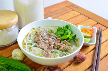 Vietnamese pho on wood table. Pho is a vietnamese traditional