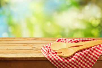 Cooking outdoor background with wooden spoons