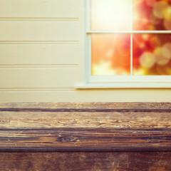 Empty wooden table over window