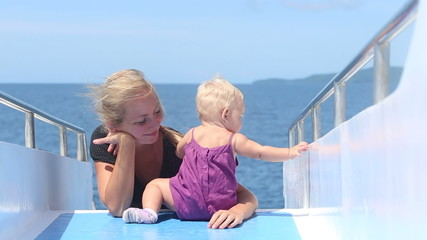 child plays mother on ship