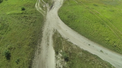 Dirt road in the field. Aerial  top view
