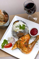 Grilled chicken, potato and cream, glass of red wine
