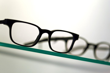 Focus of glasses on a shelf