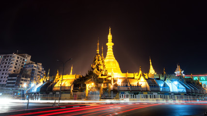 Yangon Myanmar, night cityscape with Sule pagoda in front