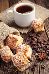 Sweet cookies of puff pastry and coffee