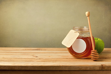 Honey and apple on wooden table with copy space