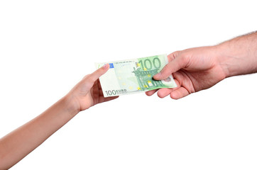man's hand gives a the bill 100 euro in a child's hand