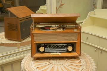 Radio with turntable, old receiver on a table with a tablecloth