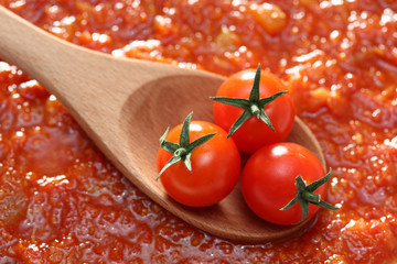 Tomato in a wooden spoon