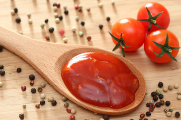 Tomato sauce in a wooden spoon