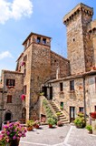 Medieval square with flowers in a Tuscan village, Italy