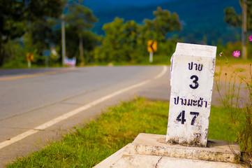 Kilometer marker to Pai in landscape