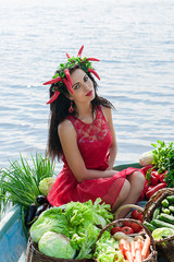 beautiful girl in the boat with vegetables