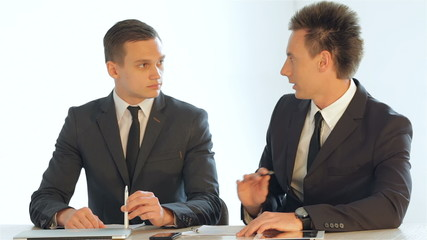 businessmen sitting at a table discussing business plan