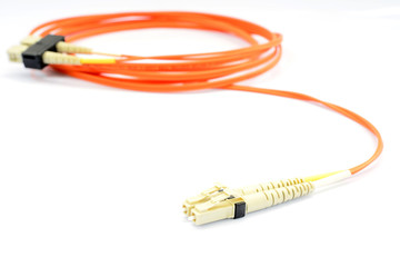Close up of a fiber optic patchcord head over white background