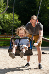 Dad with child on the playground