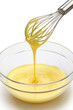 whisking egg yolks and sugar in a bowl