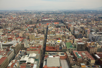 Mexico city aerial view with mountains and clouds DF