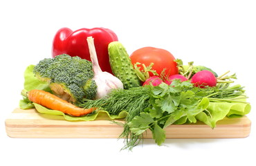 Fresh ripe raw vegetables on wooden cutting board
