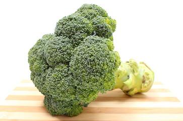 Fresh green broccoli on wooden cutting board