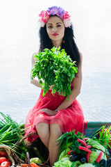 beautiful woman sitting on the boat with parsley in hand