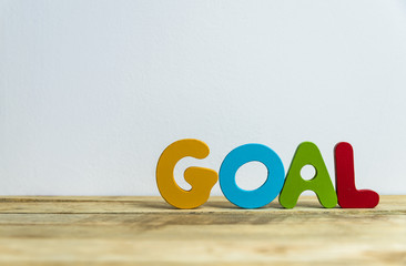 Colorful wooden word Goal with white background6