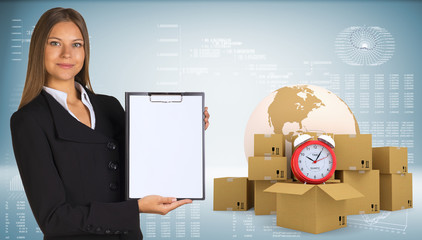 Businesswoman with Earth, alarm clock and cardboard boxes