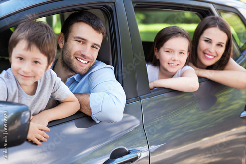 canvas print picture Happy family sitting in the car