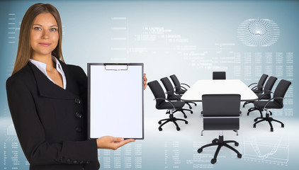 Businesswoman with conference table, chairs and laptops