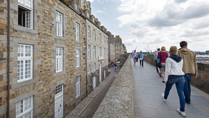People walking on the walls of Saint Malo, France.