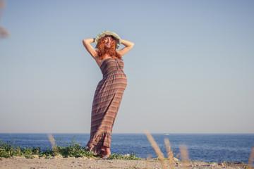Beautiful pregnant woman relaxing near the sea
