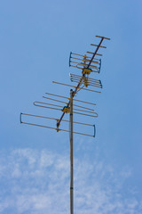 Classic Antenna like analog for TV on blue sky