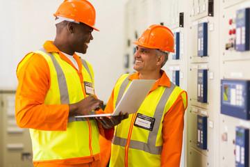 industrial engineers working in control room