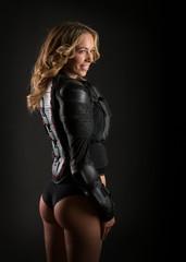 Smiling blonde young girl wear biker protector jacket