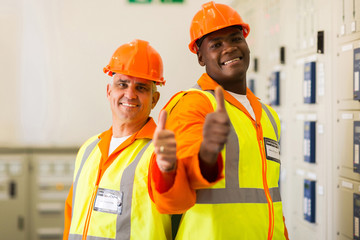 electrical engineers giving thumbs up