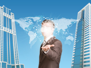 Businessman in a suit hold world map