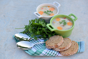 fish soup with brown bread and parsley