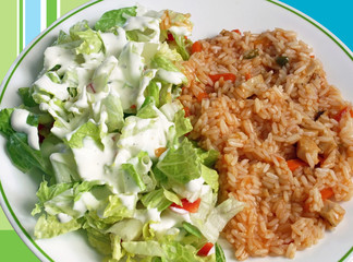 Rice with chicken in a sweet and sour sauce and salad