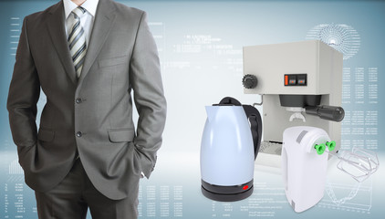 Business man with coffee machine, kettle and blender