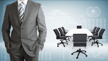 Businessman with conference table, chairs and laptops