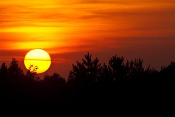 Sun Setting in a Smoky Western Sky