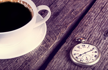 Vintage pocket watch with cup of coffee