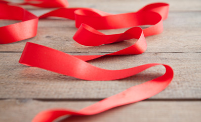 Red ribbon on a wooden board