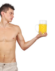 muscular man holding a glass of juice