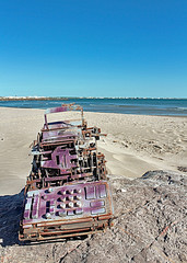 abandoned cash-register on a beach