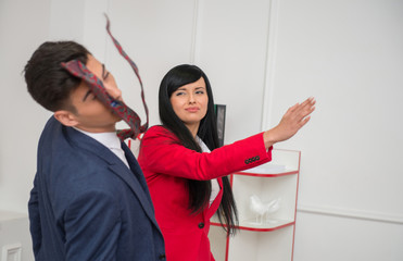 Portrait of young business woman  giving a  slap in the face to