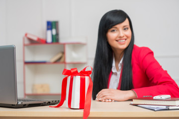 Portrait of happy smiling business woman  with a white present b