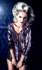 Beautiful blonde woman posing in dress