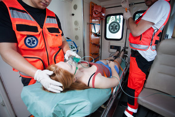 Unconscious woman and working paramedics