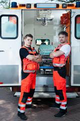 Male paramedics outside the ambulance